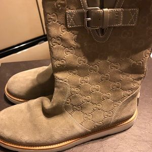 ca24c78bda0 Authentic Gucci logo printed suede boots